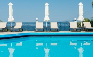 Май и Юни на о. <em>Тасос</em>, Гърция! Нощувка на човек в Двойна Стая със Закуска или Закуска и Вечеря + Басейн в Хотел Хотел Natassa***, Скала Потамия