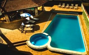 Нощувка за двама, трима или четирима + басейн и джакузи с минерална вода от Къща за гости Биг Хаус, Огняново