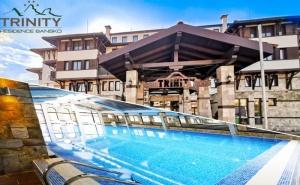 Нощувка на човек със закуска и вечеря* + басейн и уелнес център в Хотел Тринити Резидънс****, Банско