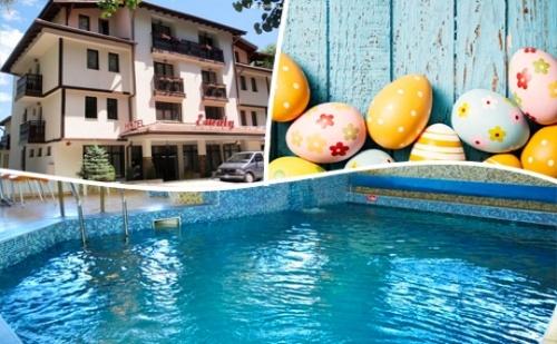 Великден в <em>Сапарева Баня</em>! 3 Нощувки на човек със Закуски и Вечери + Празничен Обяд + Басейн и Релакс Зона с Минерална Вода от Хотел Емали